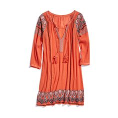 Not sure whether this is a dress or a tunic, but I love the color and the print/embroidery on the hem and sleeves.