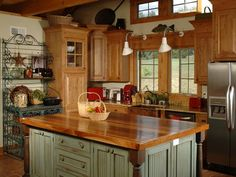 The butcher block countertop and distressed paint finish of the island lends a rustic charm to this country kitchen.