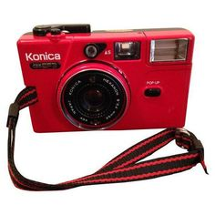 1981 Konica C35 MM Camera (525 HRK) ❤ liked on Polyvore featuring home, home decor, camera, red home decor, black home decor, black pouch, suede pouch and red pouch