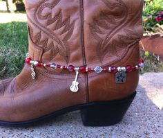 Boot Bling / Boot Candy: I made this piece with the music lover in mind. Dress up your cowboy boots or any pair of boots for that matter with this boot jewelry. Its adjustable and should fit about any type of boot. In addition to glass and metal beading, the strand has swavorski crystal beads and silver plated spacers. There is just the right amount of bling. $20.00 https://www.etsy.com/listing/113687899/boot-bling-boot-candy-hand-beaded-with