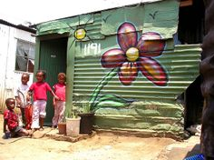 In the townships some people love to decorate their houses in this picture it shows creativity of people that live there