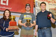 The Wells Fargo Gold Coast Award is presented by Jake Slingsby, vice president & senior business relations manager for Wells Fargo, and Callie King, operations supervisor for the Nome Wells Fargo branch to Brent Sass at the musher finisher's banquet in Nome during the 2016 Iditarod. Alaska Photo by Jeff Schultz