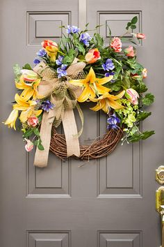 This Spring wreath is designed with Yellow Lilies, Tulips, Coral Roses and Purple Alstroemeria. The bow is made with burlap and jute ribbon. This wreath is breathtaking and will definitely add lots of bright cheery color to your front door, porch or patio. This wreath is one of a