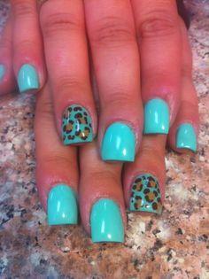 Teal cheetah acrylic nails. I like the teal but maybe the cheetah should just be regular cheetah colors?