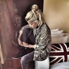 Isabel Marant sneakers styled with skinny jeans and military jacket