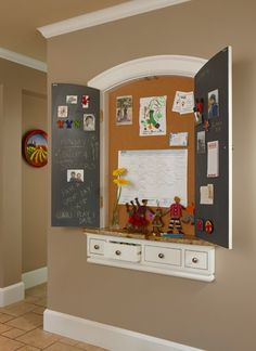 Insert the message board with doors to hide any clutter. Great Idea!