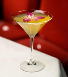 The Floating Orchid from The Mirage Hotel & Casino's Japonais restaurant  2.5 oz Stolichnaya vodka 1.5 oz Cointreau 2.5 oz pear juice 0.5 oz lemon juice & ginger ale  Shake ingredients and strain into a martini glass  Garnish with a floating orchid