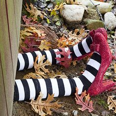Use pool noodles for the witches legs!  Get a pair of shoes from Goodwill, glitter them up!