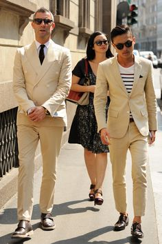 Summer suiting in cream... I think I prefer the look on the right, with the stripes and pocket square to the double-breasted style on the left.