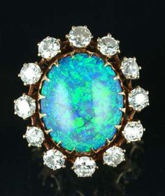 An opal and diamond ring, first half of the 20th century.