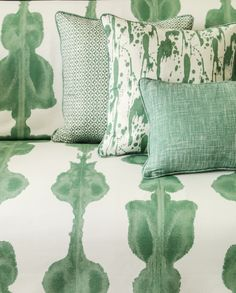 Splatter Fabric An original and evocative hand printed fabric featuring a splattered paint design, shown in lake green on a white ground.