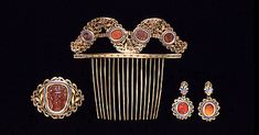 Brooch, Comb and Earrings of enamelled gold set with cornelian intaglios, French, about 1808. Made for the Empress Josephine. Private collection on loan to the V&A. Photo: V&A Images.  V&A Museum