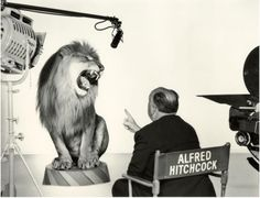 Alfred Hitchcock with MGM lion