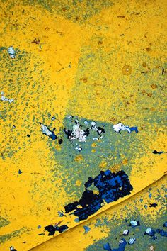On the Edge - Abstract macro shot of some yellow paint on metal