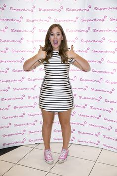 #TanyaAtSuperdrug Tanya Burr wearing a striped Topshop dress and pink converse at Superdrug