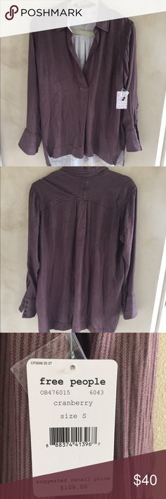 Free People Shirt Super soft fabric! This top is fully lined. The fabric color is burgundy with thin cream lines throughout. The back is longer than the front. It has wide cuffs on the sleeves with pewter buttons. Fun to wear with leggings! Free People Tops Tunics