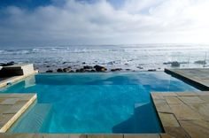 Villa Misty Cliffs is an exquisite three-bedroom situated right on the beach at Misty Cliffs. It is an ultra-luxurious designer home with South Afrika, Table Mountain, Beautiful Sunset, Cape Town, Weekend Getaways, My Dream Home, Places To See, Swimming Pools, National Parks