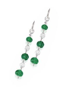 PAIR OF PLATINUM, EMERALD AND DIAMOND EARRINGS. Set with six carved emerald beads weighing approximately 13.50 carats and four briolette diamonds weighing approximately 5.30 carats, suspended by two old European-cut diamonds weighing approximately .45 carat.