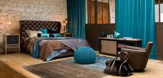 Stylish brown and teal bedroom interior