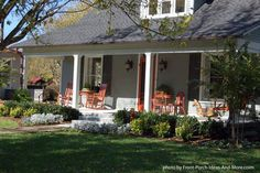 Love the pretty orange touches on this country style porch - from the rockers to the vintage screen door. Found on Front-Porch-Ideas-and-More.com