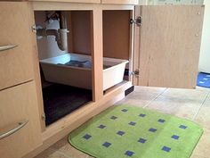 litter+box+in+small+apartment | litter box under the sink
