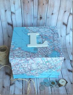 DIY Mod Podge Monogram Map Box from Setting for Four (great for my international postcards!)