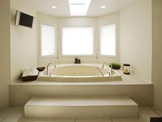 Two-Person Jacuzzi  A two-person Jacuzzi tub and a muted color palette turn this bathroom into a relaxing retreat. The wall-mounted television adds an extra touch of luxury. Design by Vanessa DeLeon
