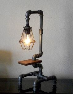 Industrial Pipe Desk Table with reclaimed wood lamp.