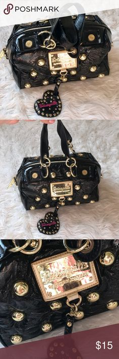 BETSEY JOHNSON BLACK HANDBAG GOLD STUDS BAG PURSE This black shiny faux leather handbag is so rad!! The gold stud hardware makes a bold yet classy statement! Nothing is better then black and gold! Good used condition, minor wear on the gold feet as shown in pics. Perfect for everyday use, year round! Great medium sized bag! Betsey Johnson Bags Satchels
