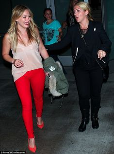 Supporting fellow artists: Hilary Duff was stunning in red as she attended the Pink concert in Los Angeles on Saturday night looking radiant...