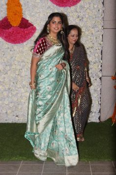 Isha Ambani Poses With Her Mother-in-Law As She Arrives For Diwali Bash At Jio World Centre - HungryBoo Best Blouse Designs, Sari Blouse Designs, Paris Fashion, Fashion Show, Women's Fashion, Saree Trends, Most Beautiful Indian Actress, Traditional Looks, Maroon Color