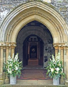 Perfect arch ways need framing.... Beaut little milk churns packed out with rustic glamorous country flowers using opulent white hydrangeas and delphinium.