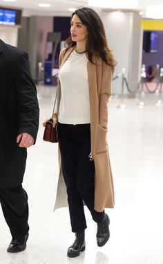 Amal trades in the designer clothes for a more casual but still chic look while jetting out of NY.