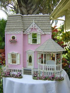 Love the gingerbread trim and gazebo on Robin's Miss Muffet Dollhouse.