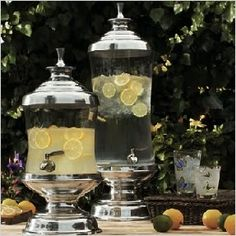 Beautiful drink dispensers are a fun (and pretty) way to let guests serve themselves.  I also like the DIY addition of little name plates letting your guests know what the different dispensers contain.