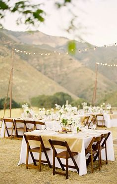 Burlap overlays on wedding guest tables. The white linens underneath keep it from being too country looking. Rustic elegant, nice. Scroll to number 16 on the page.