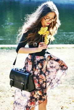 floral chic. I'm a big fan of the glasses and bright pink lips.