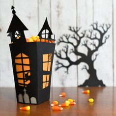 Using your cutting machine, transform an ordinary popcorn box into a spooky haunted house!