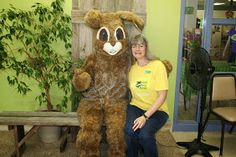Center volunteer, Shannon, has her picture taken with Ambassador Cottontail at SpringTails 2014.