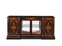 A mid Victorian ebonised, purplewood and fruitwood inlaid breakfront low cabinet