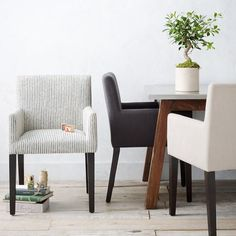 Porter Upholstered Armchair | west elm.  Our current dining chairs (in the light cream color.  2 with arms, 4 without).  We could keep or give them away.