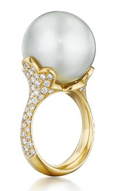 A Cultured Pearl and Diamond Ring Set with a South Sea cultured pearl, measuring approximately 17.40 mm, to the floral motif pavé-set diamond prong and band, mounted in 18K yellow gold,