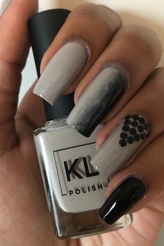 A simple grey and black nail design