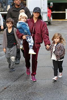 Kourtney Kardashian wearing Kanye Life of Pablo Alpha Industries Flight Jacket in Maroon, APL Athletic Propulsion Labs Techloom Phantom Sneakers in Wine, Msfts Reverse-Rep Cap and Naked Wardrobe Velvet Views Sweat Suit