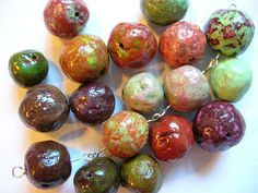 How to Make Beautiful Beads From Recycled Newspaper ~~ great weekend craft and cool jewelry to boot!  it's like a mache', but with more finishing steps.