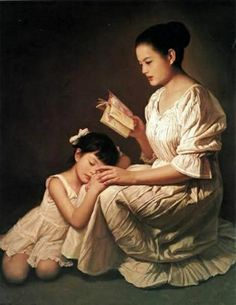 Asian mother reading to daughter