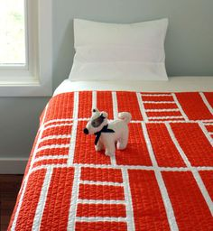 Contemporary Tangerine Baby Blanket // Best of Etsy: Modern Quilts for Fellow Pattern Lovers via Brit + Co.