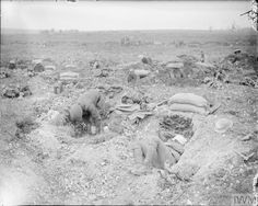 WWI, 1916, Somme; Battle of Bazentin Ridge. British troops resting in their rifle shooting dugouts at Mametz Wood (looking west) ©IWM