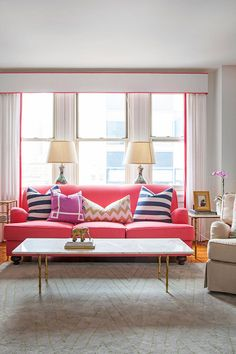 Caitlin Wilson's candy pink couch accentuates the subtler pink piping on her curtains.
