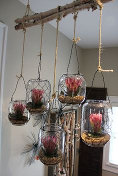 and bundled birch branches hold rustic vases...